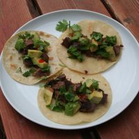 Tacos de lengua served on a plate