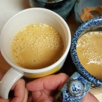 Salted Caramel Apple Cider in mugs with mama's hands and child's hands