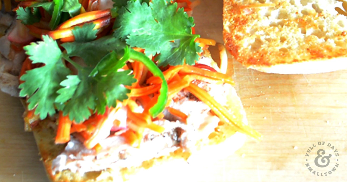 Chicken Banh Mi with pickled radish and carrot salad, cilantro and sliced jalapenos.