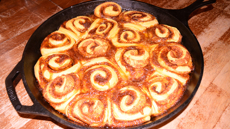 Sourdough Sweet Potato Cinnamon Rolls baked in a cast iron skillet. YUM!