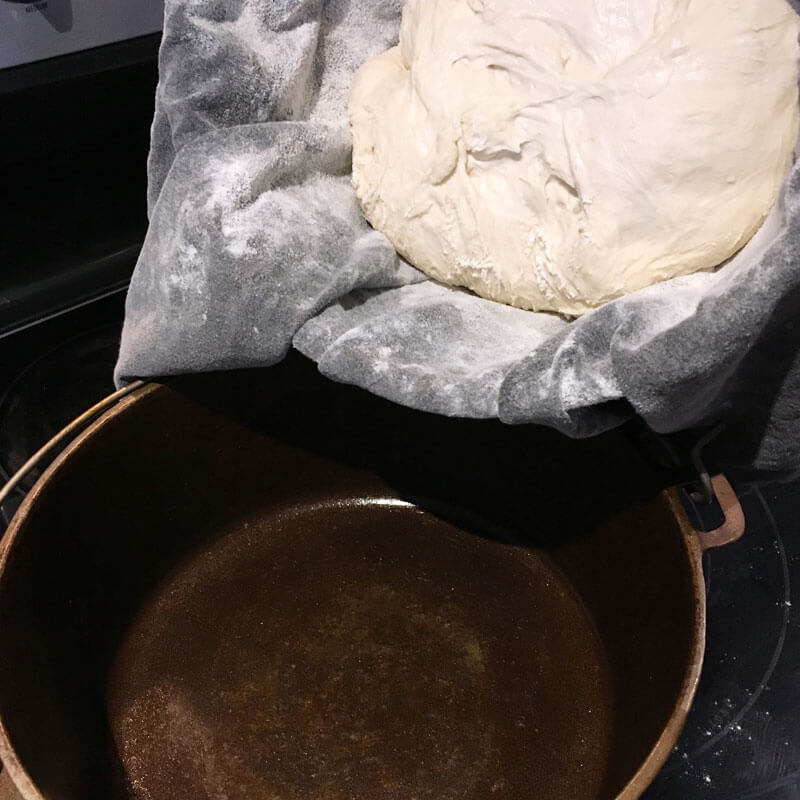 Transfer dough to a preheated Dutch oven.